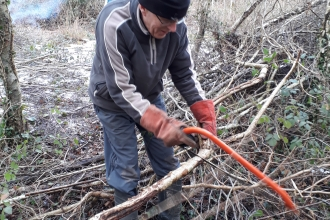 Volunteer at work on nature reserve