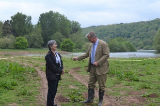 Bill Wiggin MP and HWT Chief Executive Helen Stave cutting the ribbon at new reedbed site.