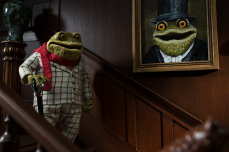 Character of Toad from Wind in the Willows stood on staircase